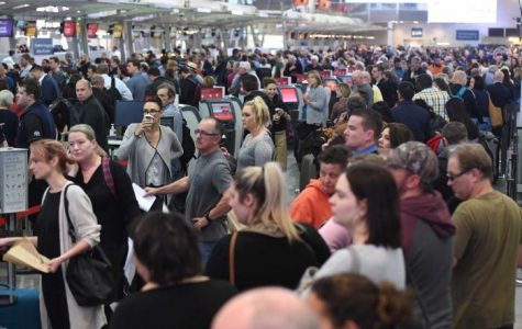 Crowded Sydney airport due to added security after thwarted terror attack.